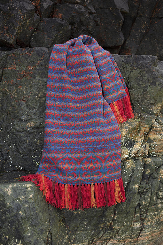 Suzani Wrap hand knitwear design in blue colourway from the book A Collector's Item by Jade Starmore