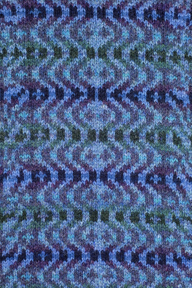 Detail of the Selkie Pullover patterncard kit by Alice Starmore in Sea Colourway
