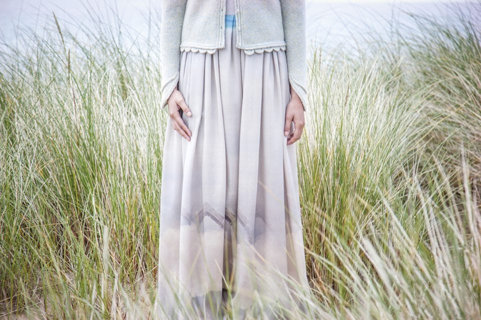 Detail of the white Raven dress in the machair grasses