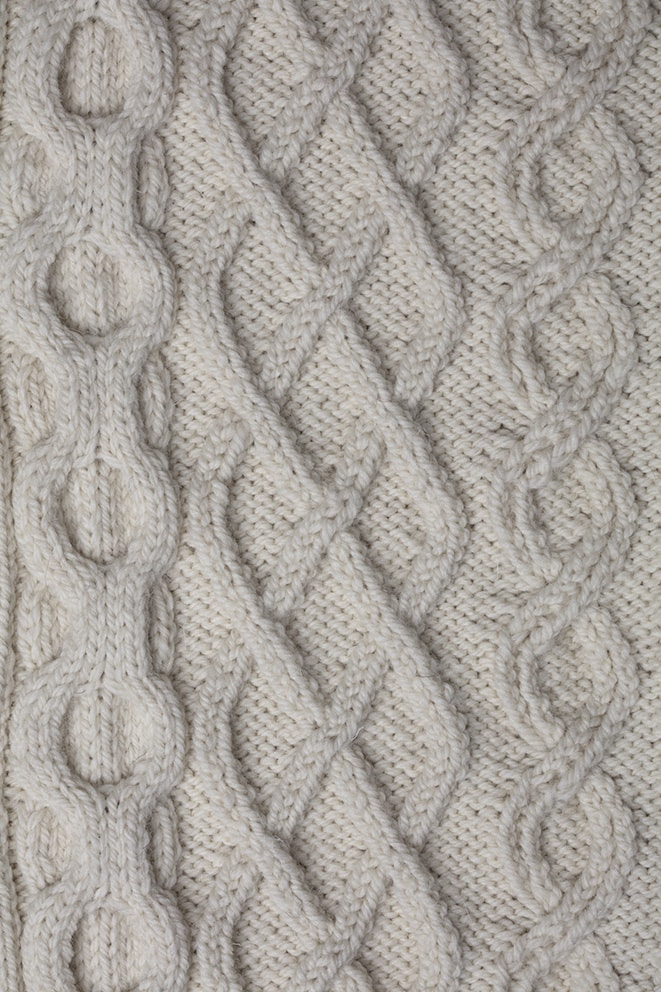 Detail of the Aranmor knitwear design from Aran Knitting by Alice Starmore in pure wool Bainin hand knitting yarn