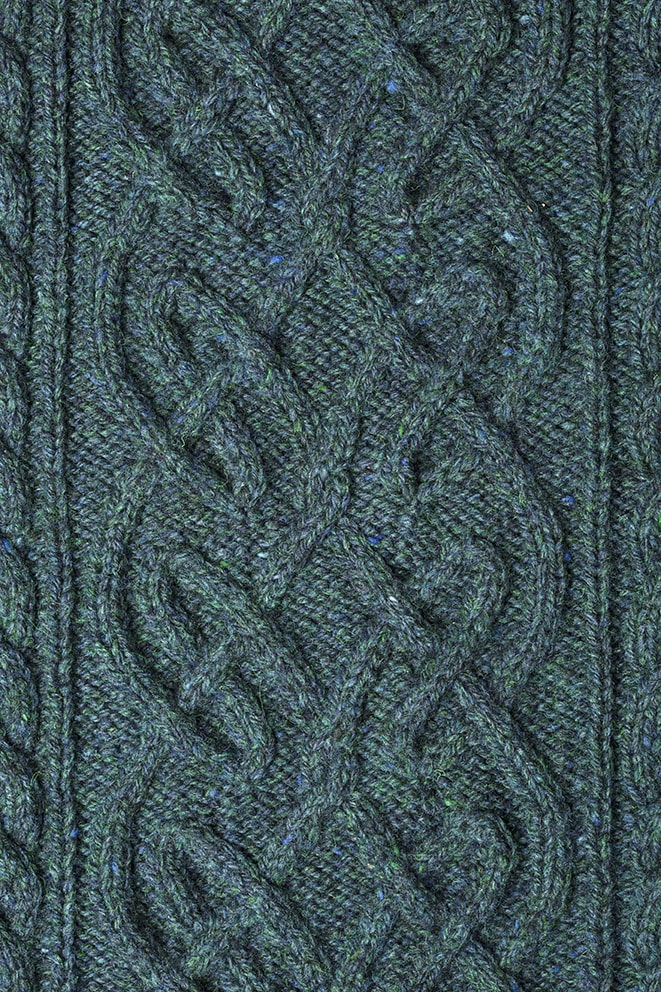 Detail of the St Brigid knitwear design from Aran Knitting by Alice Starmore in pure wool Hebridean 3 Ply hand knitting yarn