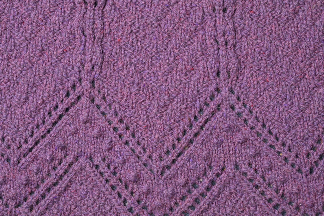 Detail of the Secret Garden knitwear design from The Children's Collection by Alice Starmore in pure wool Hebridean 3 Ply hand knitting yarn