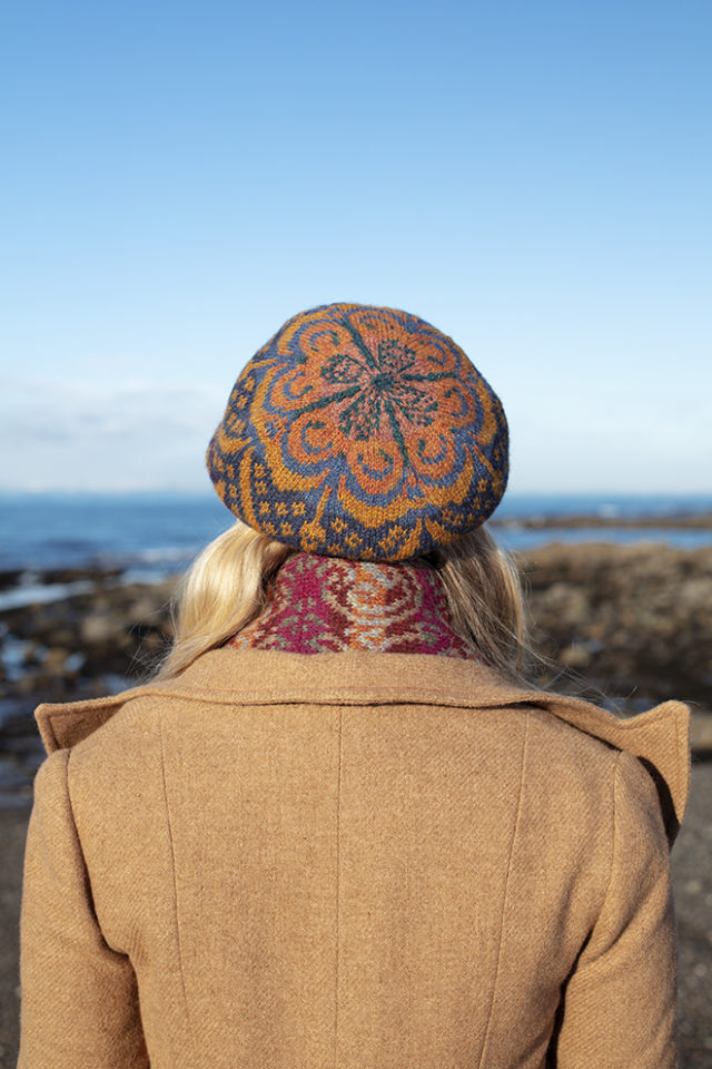 Musician Laura Durrant wearing the Lovebirds Scarf in Fireside colourway and Mary Tudor Hat