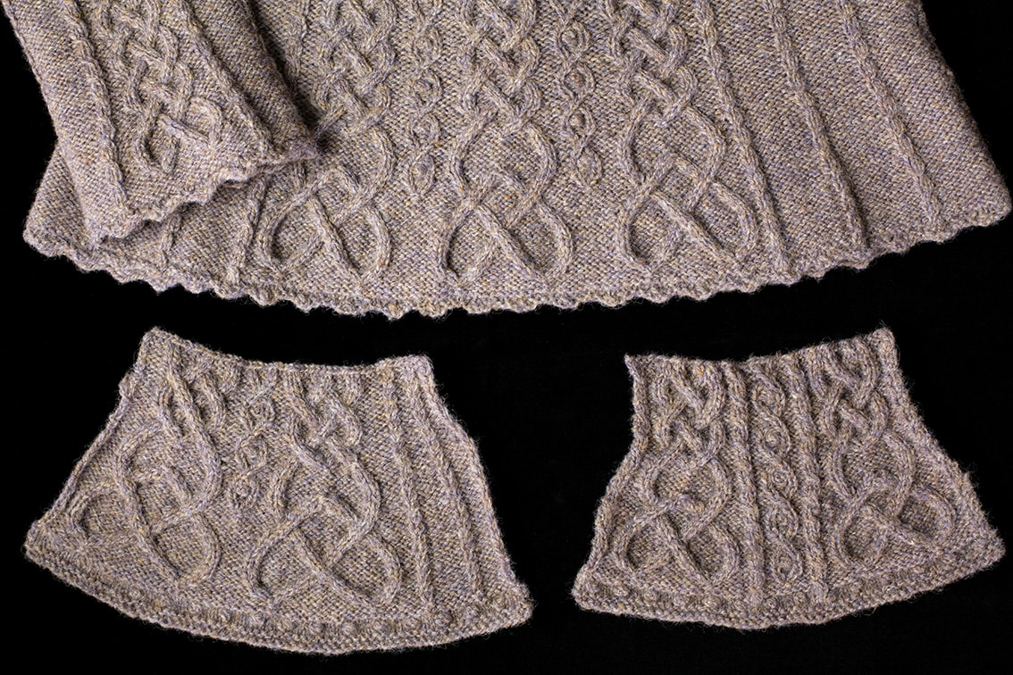 The hem of the Eala Bhan design from Aran Knitting by Alice Starmore along with two developmental swatches